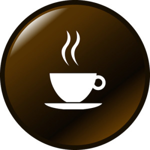 Steaming cup of coffee on brown button